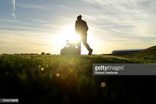 Greenskeepers prepare the course ahead of the 2018 Ryder Cup at Le Golf National on September 24 2018 in Paris France