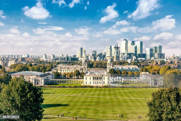 greenwich college with the financial district of the docklands in the background,  greenwich park. - royalty stock pictures, royalty-free photos & images