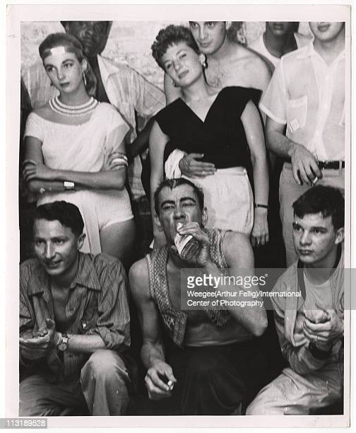 Greenwich Village party ca 1961 Photo by Weegee /International Center of Photography/Getty Images