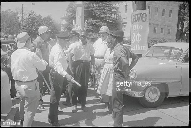 Both whites and Negroes were asked to keep moving here 4/2 after Negroes had finished their registration at the county courthouse Some Negroes failed...