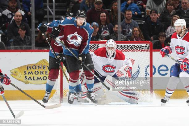 J Greer of the Colorado Avalanche looks to deflect a shot past goaltender Antti Niemi of the Montreal Canadiens at the Pepsi Center on February 14...
