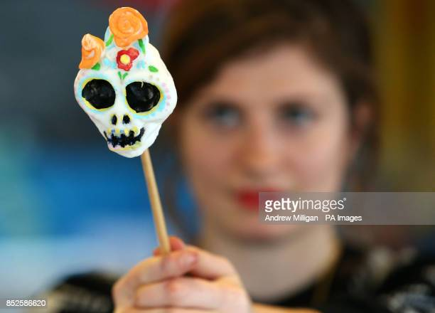 Greer Pester from Glasgow holds a sugar skull as she makes a shrine to her late aunt Jacqueline Pester at a shrine making workshop at the Gallery of...