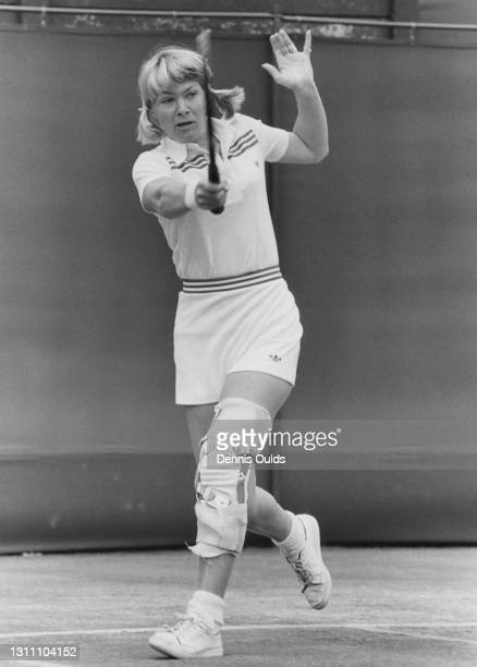 Greer Stevens of South Africa wearing a supporting leg brace makes a forehand return to Martina Navratilova during their Women's Singles Fourth Round...