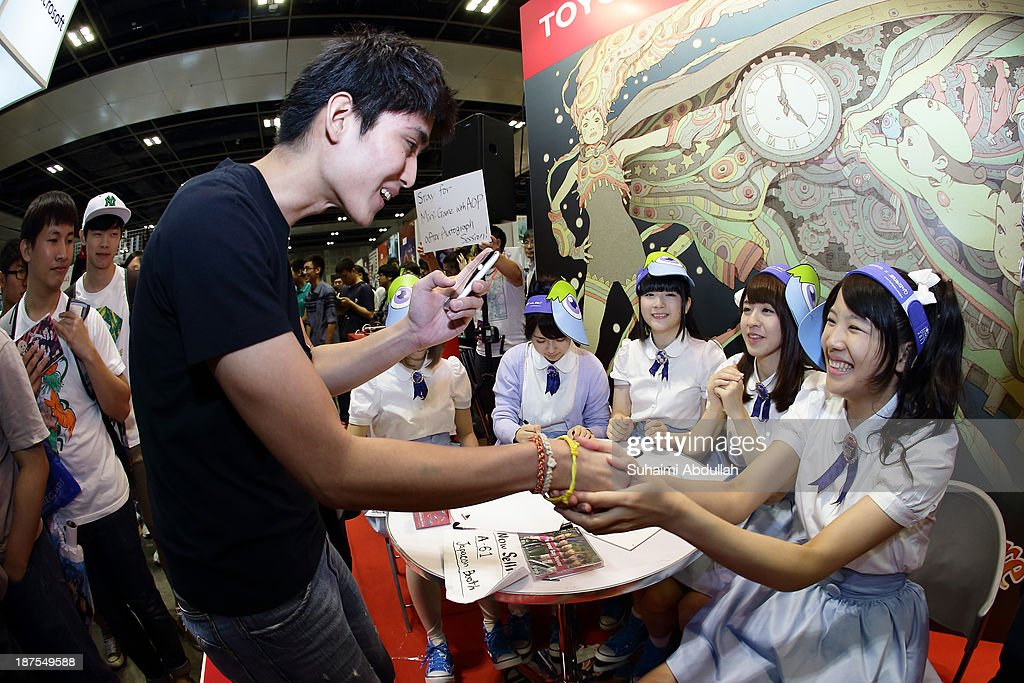 AOP greet fans and signs autographs at the TOYOTA x Studio4C booth during the Anime Festival Asia 2013 at Suntec Convention & Exhibition Center on November 10, 2013 in Singapore.