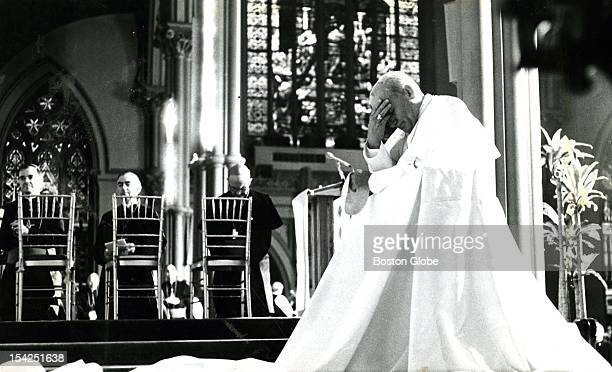 Greeted by nearly 2000 priests in a cheering and footstomping welcome at the Cathedral of the Holy Cross Pope John Paul II first made his way to the...