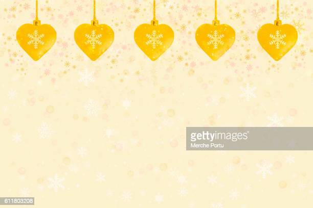 Greeting card Christmas with yellow hanging hearts