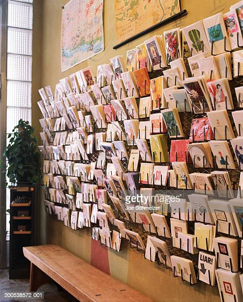 greeting cards displayed on wall in shop - greeting card stock pictures, royalty-free photos & images