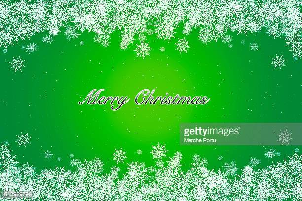 Greeting Christmas card with green background and snowflakes