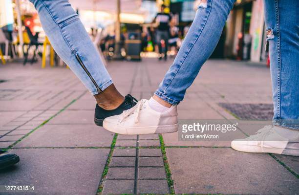 """covid-19 greeting concept. """"foot shake"""" - avoidance stock pictures, royalty-free photos & images"""
