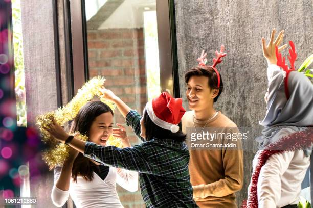Greeting friends during Christmas celebration at home in Kuala Lumpur