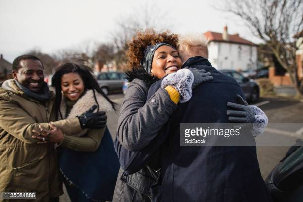 greeting in the street - black stock pictures, royalty-free photos & images