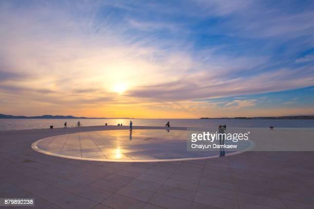 Greeting Sun Zadar Croatia People at sunset