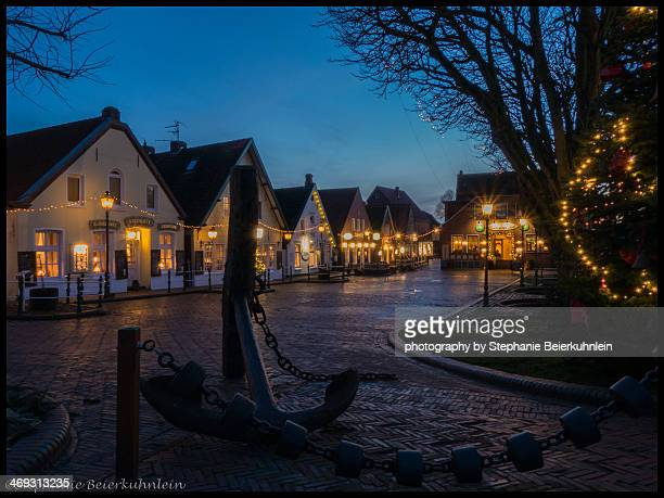 greetsiel old fishermen`s cottage - side by side stock pictures, royalty-free photos & images