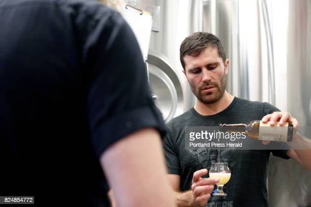 Greg Abbot prepares to sample an Icelandic beer Thursday at Liquid Riot on Commercial Street while collaborating on a smallbatch brew with Stulli...