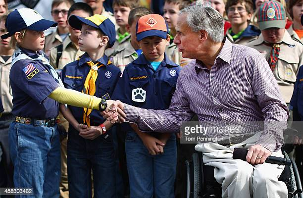 Greg Abbott a candidate for governor greets a Cub Scout prior to the NASCAR Sprint Cup Series AAA Texas 500 at Texas Motor Speedway on November 2...