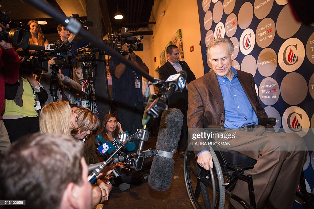 Greg Abbott, governor of Texas, arrives in the media staging area following a campaign rally for Republican presidential hopeful Sen. Ted Cruz in Dallas, Texas February 29, 2016, one day before the 'Super Tuesday' primaries. Americans in a dozen states head to the polls for a slew of primaries and caucuses March 1 on what is considered the most important day of the presidential nominations calendar. / AFP / Laura Buckman