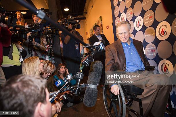 Greg Abbott governor of Texas arrives in the media staging area following a campaign rally for Republican presidential hopeful Sen Ted Cruz in Dallas...
