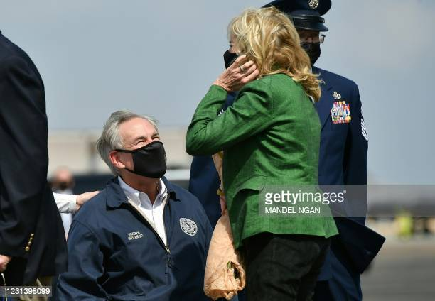 Greg Abbott, Governor of Texas greets First Lady Jill Biden upon arrival at Ellington Field Joint Reserve Base in Houston, Texas on February 26,...