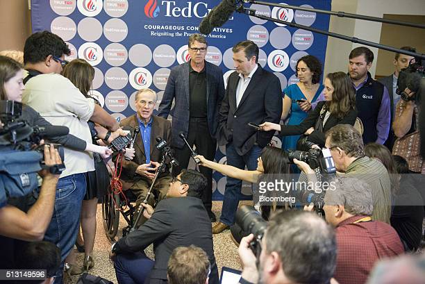Greg Abbott governor of Texas left speaks to the media while Rick Perry former governor of Texas center and Senator Ted Cruz a Republican from Texas...