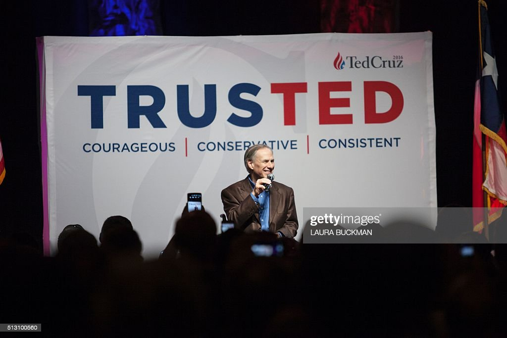 Greg Abbott, governor of Texas, speaks at a campaign rally for Republican presidential hopeful Sen. Ted Cruz in Dallas, Texas February 29, 2016, one day before the 'Super Tuesday' primaries. Americans in a dozen states head to the polls for a slew of primaries and caucuses March 1 on what is considered the most important day of the presidential nominations calendar. / AFP / Laura Buckman