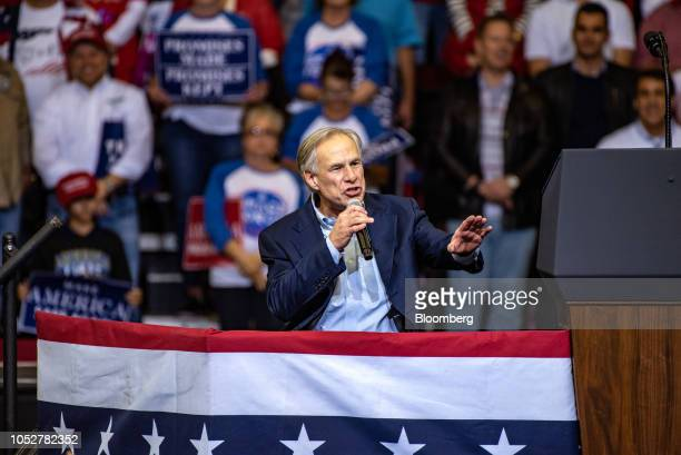 Greg Abbott governor of Texas speaks during a campaign rally with US President Donald Trump for Senator Ted Cruz not pictured in Houston Texas US on...