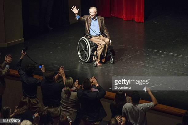 Greg Abbott governor of Texas talks to attendees ahead of a speech by Senator Ted Cruz a Republican from Texas and 2016 presidential candidate during...