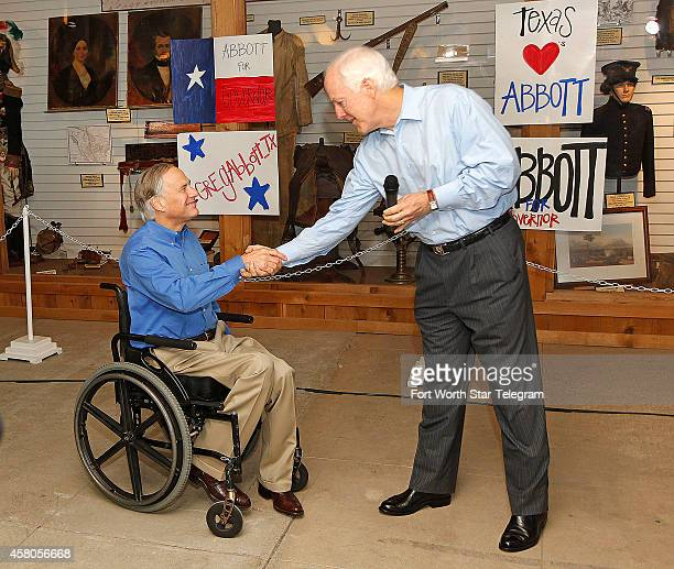 Greg Abbott left candidate for Texas Governor and US Sen John Cornyn shake hands during a campaign rally on Wednesday Oct 29 in Fort Worth Texas