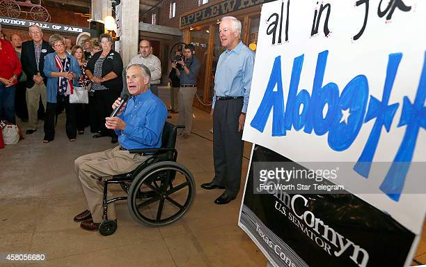 Greg Abbott left candidate for Texas Governor and US Sen John Cornyn during a campaign rally on Wednesday Oct 29 in Fort Worth Texas