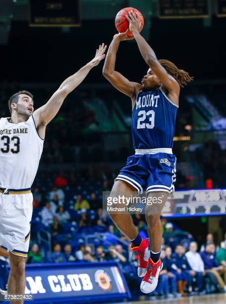 Greg Alexander of the Mount St Mary's Mountaineers shoots the ball against John Mooney of the Notre Dame Fighting Irish at Purcell Pavilion on...
