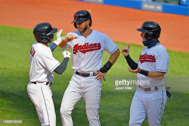 Greg Allen celebrates with Mike Freeman and Jordan Luplow of the Cleveland Indians after all scored on a homer by Allen during the ninth inning...