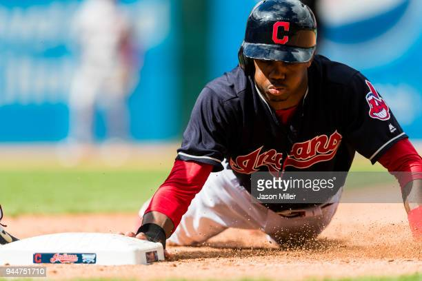 Greg Allen of the Cleveland Indians dives back to first base during the seventh inning against the Minnesota Twins at Progressive Field on September...