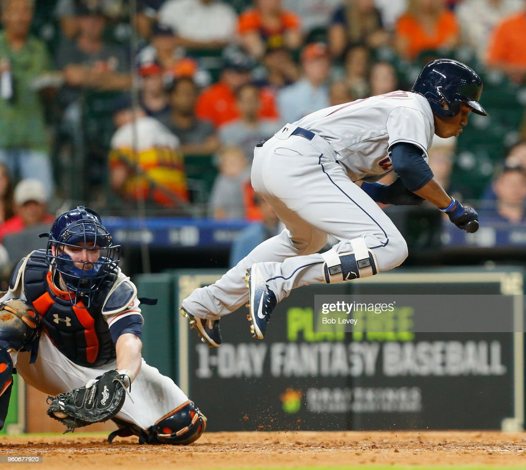 Greg Allen #1 of the Cleveland Indians leaps to avoid being hit by a pitch as Brian McCann #16 of the Houston Astros catches the ball in the sixth inning at Minute Maid Park on May 20, 2018 in Houston, Texas.