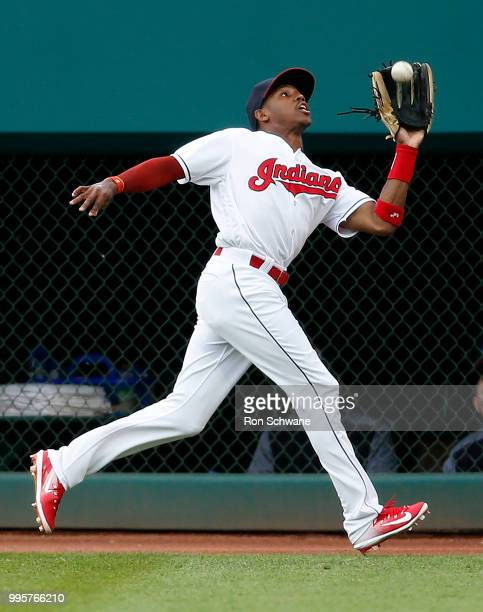 Greg Allen of the Cleveland Indians makes a running catch to get out Scooter Gennett of the Cincinnati Reds during the fourth inning at Progressive...