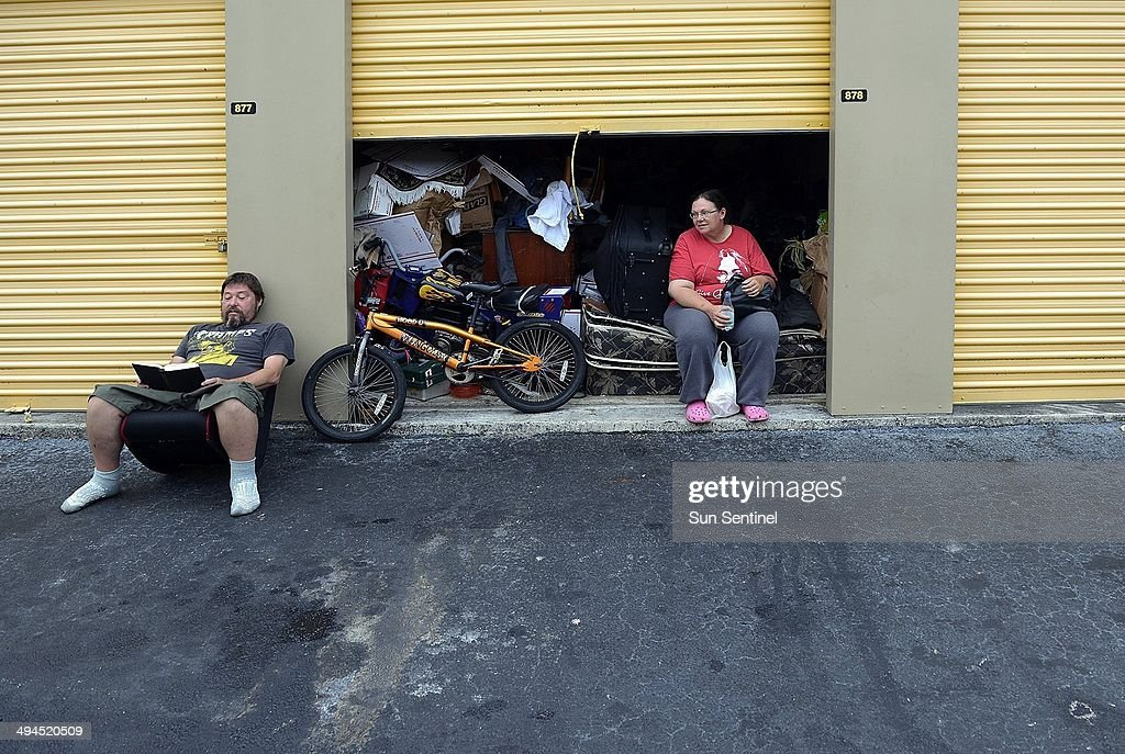 Greg and Daphne Young relax outside the Uncle Bobu0027s Self Storage in Hollywood Fla. & Sleeping in storage units Pictures | Getty Images