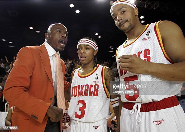 Greg Anthony coach of Clutch City talks with Bow Wow left and Donald Fasion during the McDonalds Celebrity game on Center Court at Jam Session during...