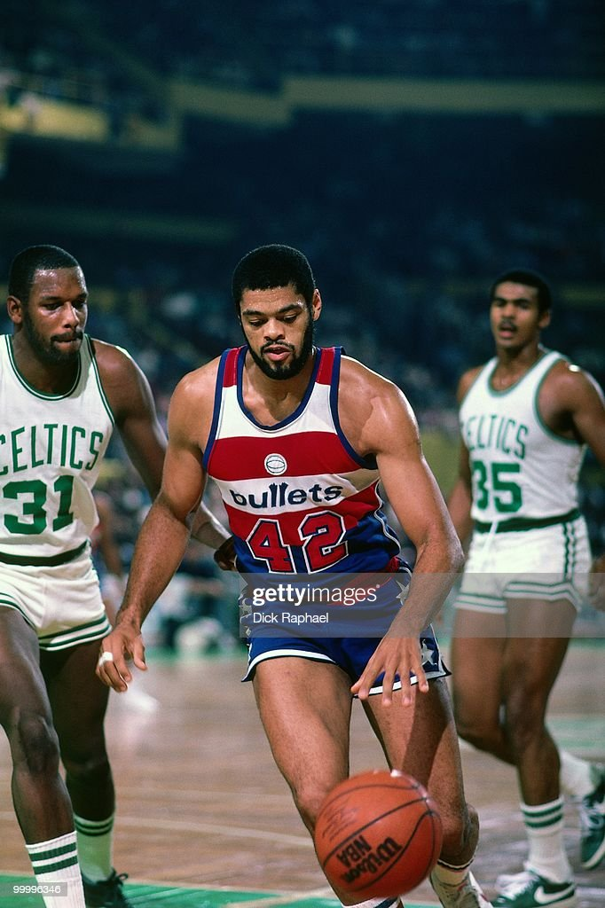 Greg Ballard #42 of the Washington Bullets drives to the basket against Cedric Maxwell #31 of the Boston Celtics during a game played in 1983 at the Boston Garden in Boston, Massachusetts.