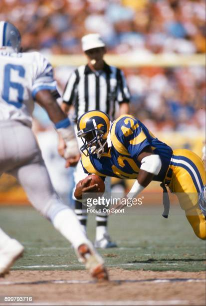 Greg Bell of the Los Angeles Rams carries the ball against the Detroit Lions during an NFL football game September 11 1988 at Anaheim Stadium in...