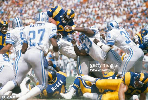 Greg Bell of the Los Angeles Rams dives over the top against the Detroit Lions during an NFL football game September 11 1988 at Anaheim Stadium in...