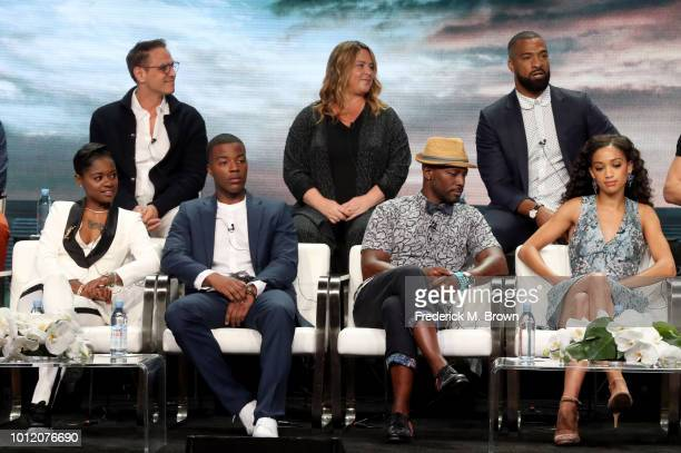 Greg Berlanti April Blair Spencer Paysinger BreZ Daniel Ezra Taye Diggs and Samantha Logan All American speak onstage at the CW Network portion of...