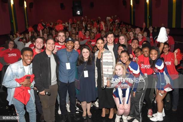 "Greg Berlanti, Terayle Hill, Becky Albertalli, Alexandra Shipp, and Nick Robinson pose with movie audience members at ""Love, Simon"" Atlanta Fan..."
