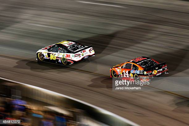 Greg Biffle driver of the 3M Call Before You Dig Ford leads Tony Stewart driver of the Bass Pro Shops/Mobil 1 Chevrolet during the NASCAR Sprint Cup...