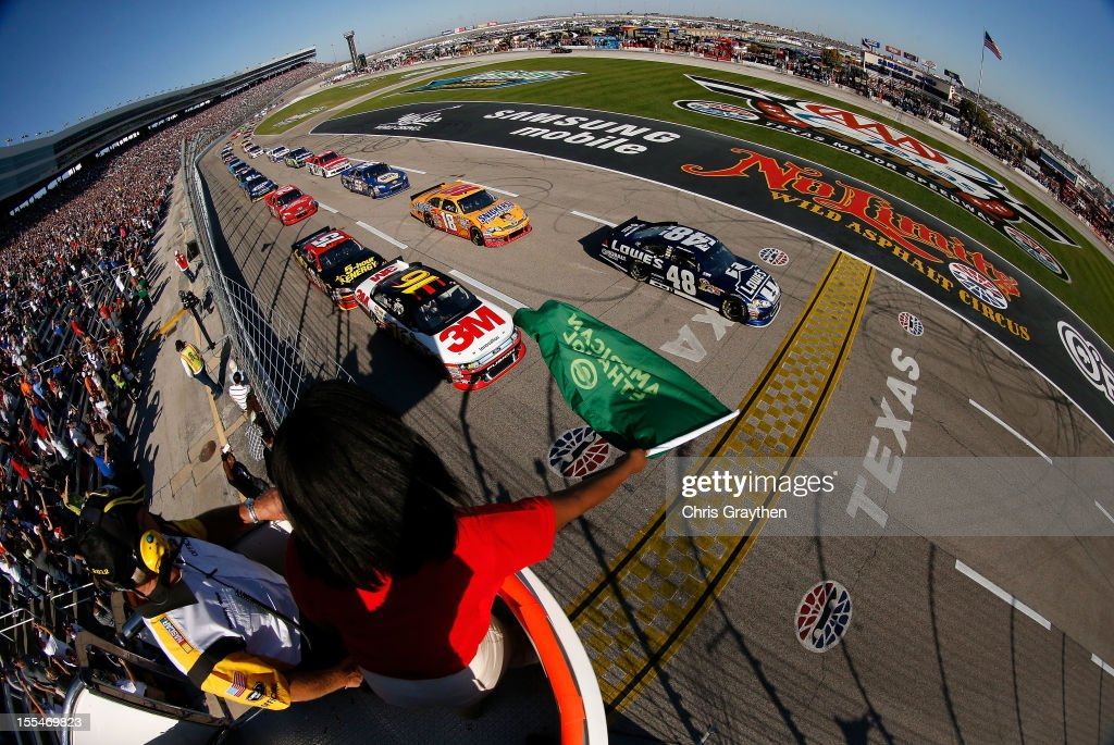 Greg Biffle, driver of the #16 3M Ford and Jimmie Johnson, driver of the #48 Lowe's Chevrolet, lead the field at the start of the NASCAR Sprint Cup Series AAA Texas 500 at Texas Motor Speedway on November 4, 2012 in Fort Worth, Texas.