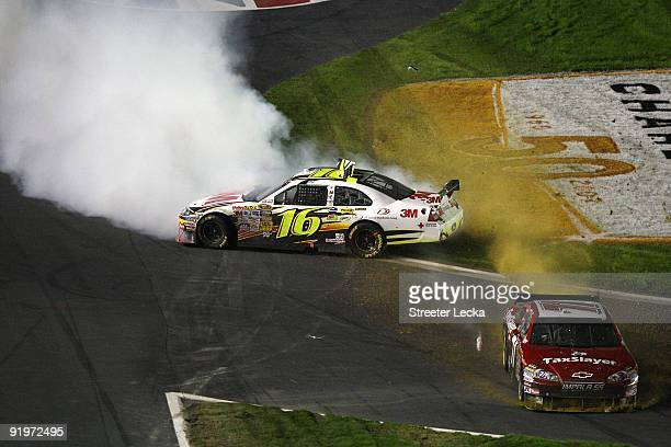 Greg Biffle driver of the 3M Ford and Mike Bliss driver of the Taxslayercom Chevrolet slide through the infield after crashing during the NASCAR...