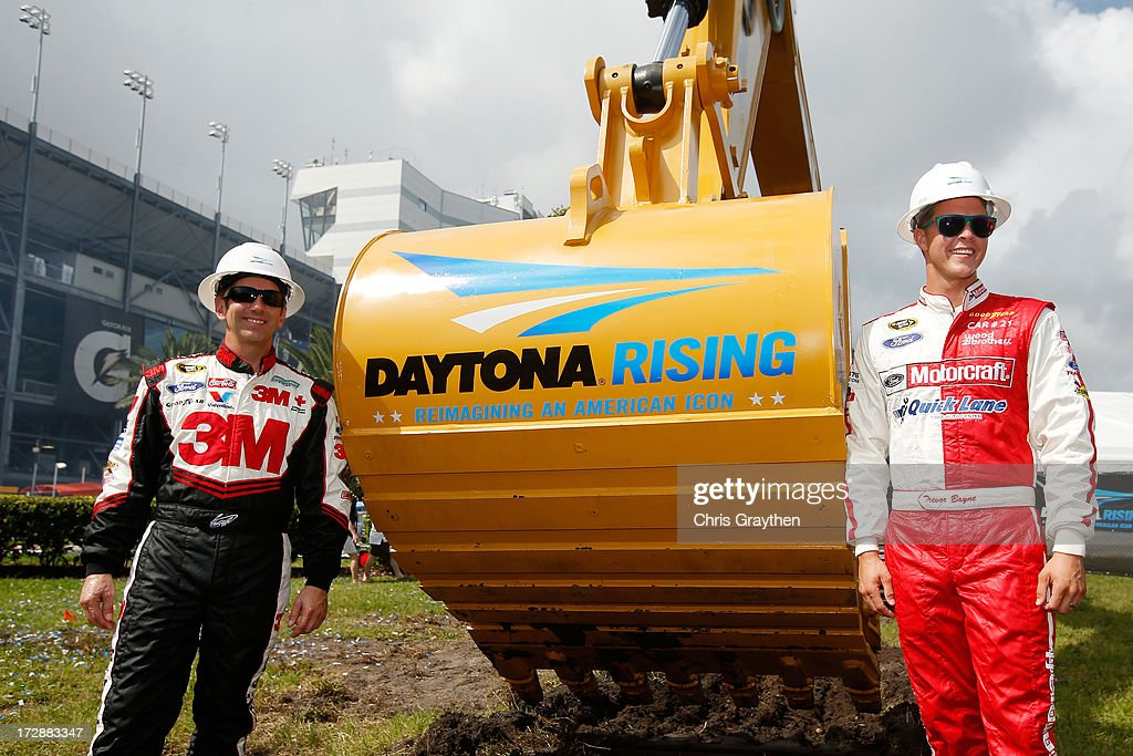 Greg Biffle, driver of the #16 3M Ford, and Trevor Bayne, driver of the #21 Motorcraft / Quick Lane Tire & Auto Center Ford, pose for a photo during the Daytona Rising groundbreaking ceremony at Daytona International Speedway on July 5, 2013 in Daytona Beach, Florida.