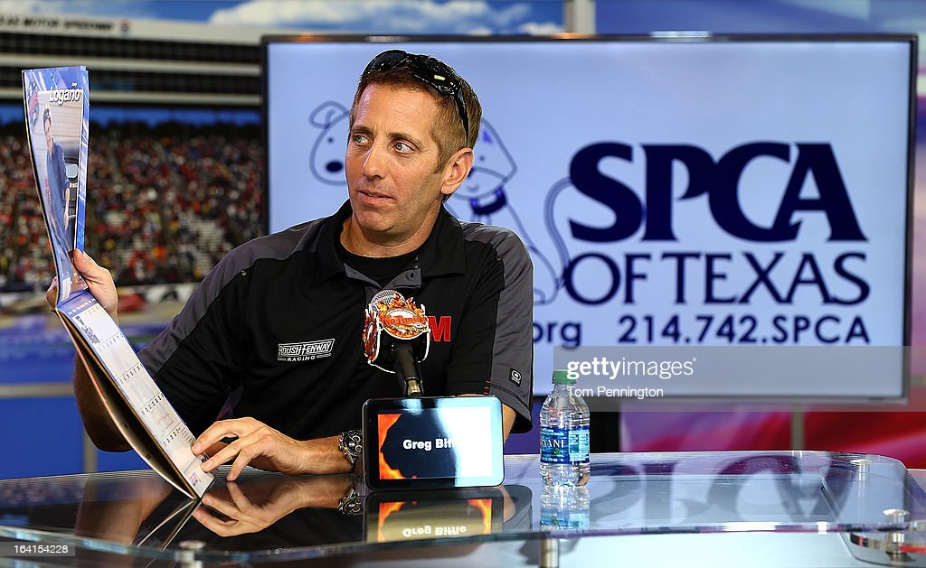Greg Biffle, driver of the #16 3M Ford Fusion, displays a NASCAR pets calendar during an event at Texas Motor Speedway on March 20, 2013 in Fort Worth, Texas. Biffle and his wife, Nicole started the Greg Biffle Foundation which supports over 500 humane societies and animal shelters across the country.