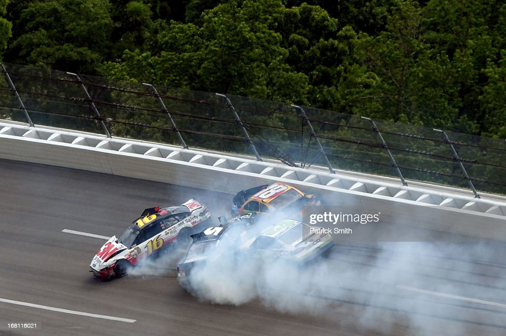 Greg Biffle, driver of the #16 3M Safety Ford, Kasey Kahne, driver of the #5 Time Warner Cable Chevrolet, Kyle Busch, driver of the #18 M&M's Toyota and Casey Mears, driver of the #13 GEICO Ford, are invovled in a wreck along the wall during the NASCAR Sprint Cup Series Aaron's 499 at Talladega Superspeedway on May 5, 2013 in Talladega, Alabama.