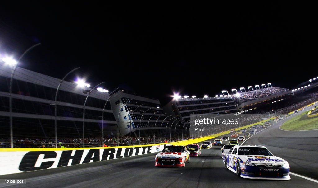 Greg Biffle, driver of the #16 3M/IDG Ford, and Mark Martin, driver of the #55 Aaron's Dream Machine Toyota, lead the field during pace laps prior to the start of the NASCAR Sprint Cup Series Bank of America 500 at Charlotte Motor Speedway in Concord, North Carolina.