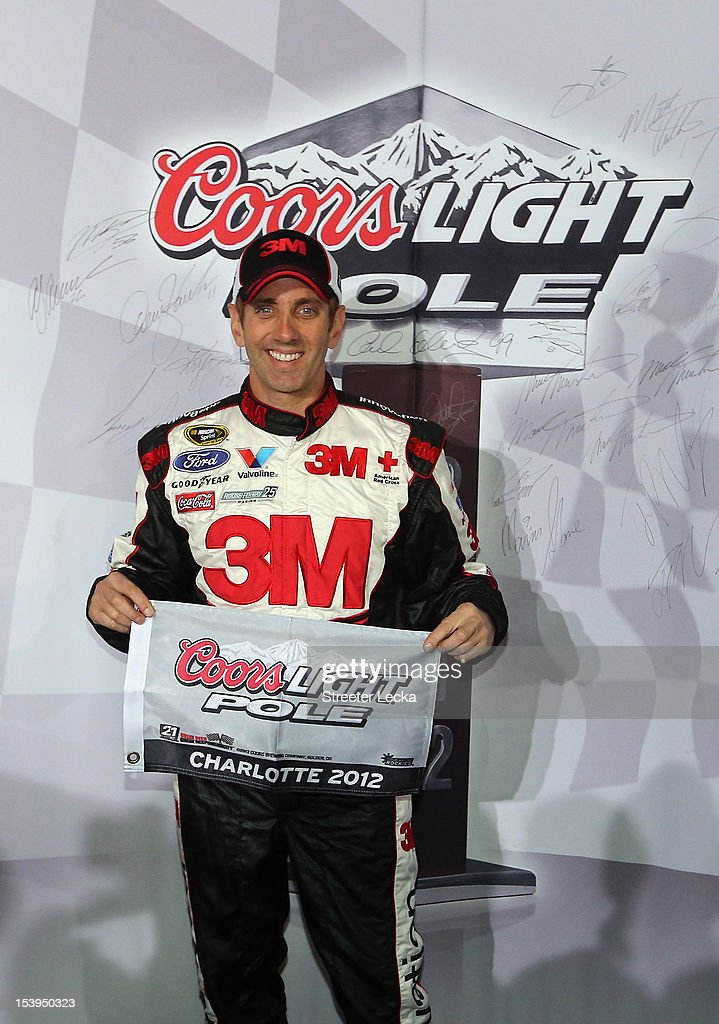 Greg Biffle, driver of the #16 3M/IDG Ford, poses with the pole award after qualifying for pole position for the NASCAR Sprint Cup Series Bank of America 500 at Charlotte Motor Speedway on October 11, 2012 in Charlotte, North Carolina.