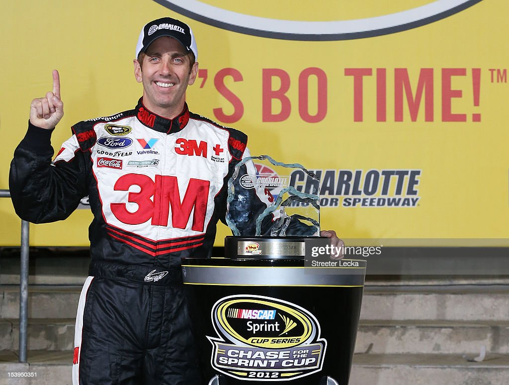 Greg Biffle, driver of the #16 3M/IDG Ford, poses with the pole award trophy after qualifying for pole position for the NASCAR Sprint Cup Series Bank of America 500 at Charlotte Motor Speedway on October 11, 2012 in Charlotte, North Carolina.
