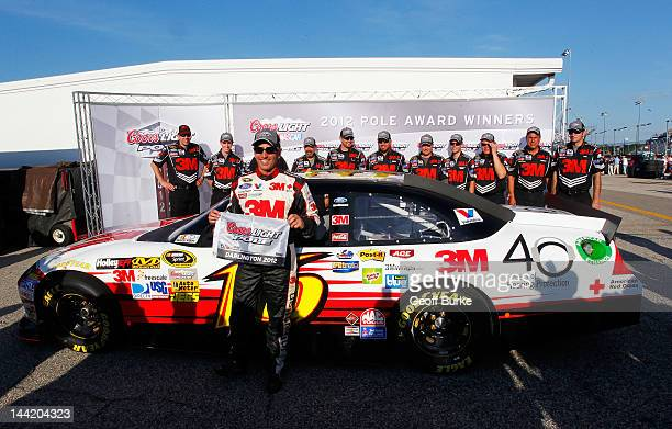 Greg Biffle driver of the 3M/OH/ES Ford poses with the Coors Light Pole Award after qualifying for pole position for the NASCAR Sprint Cup Series...